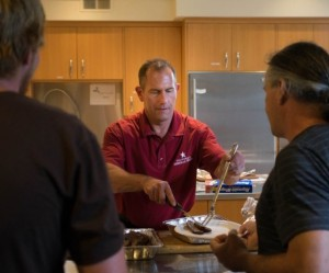 Monterey District General Manager Eric Sabolsice Serving Food at Carmel's AmerICANs in Action! Event at the Local Homeless Shelter
