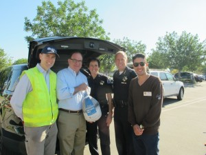 Suburban Water Systems' Craig Gott (left) with Senator Bob Huff and Charity Volunteers at Suburban's Operation Gobble Event.