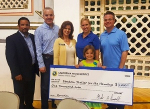 L-R: Cal Water District Manager John Freeman, Stockton City Councilmember Michael Blower, Assembly Member Susan Eggman's representative Zenet Negron, Stockton City Council Member Christina Fugazi and Stockton Shelter for the Homeless CEO Adam Cheshire with his daughter.