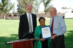 Company President Bob Nicholson (l) and Chairman and CEO Mike Whitehead receive a congratulatory California State Assembly Resolution from Assembly Member Cheryl Brown.