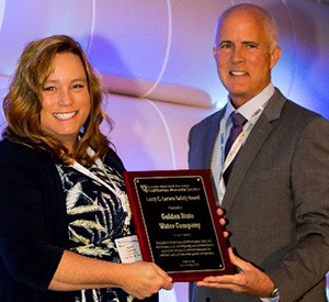 Brandy Hancocks, Golden State Water, Environmental, Health & Safety Compliance Manager accepting the Larry C. Larson Safety Award
