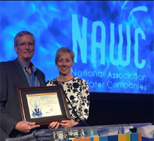 Robert Sprowls, Golden State Water President and CEO, accepting the NAWC Management Innovation Award, along with Denise Kruger, Golden State Water Senior Vice President of Regulated Utilities
